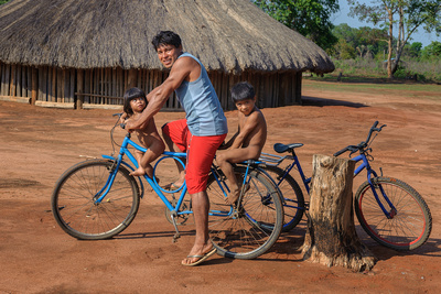 Man on bicycle with his two children