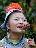 Gejia girl smelling flowers