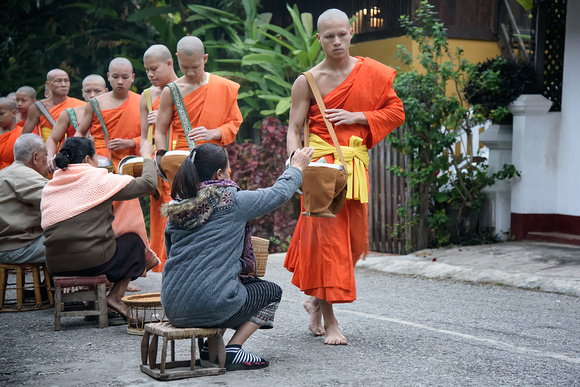 Collecting alms in Laos